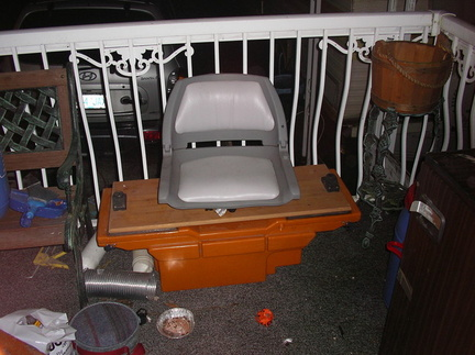 Metzler storage/swivel seat/rod holders. Can hold batteries and or gas tank.